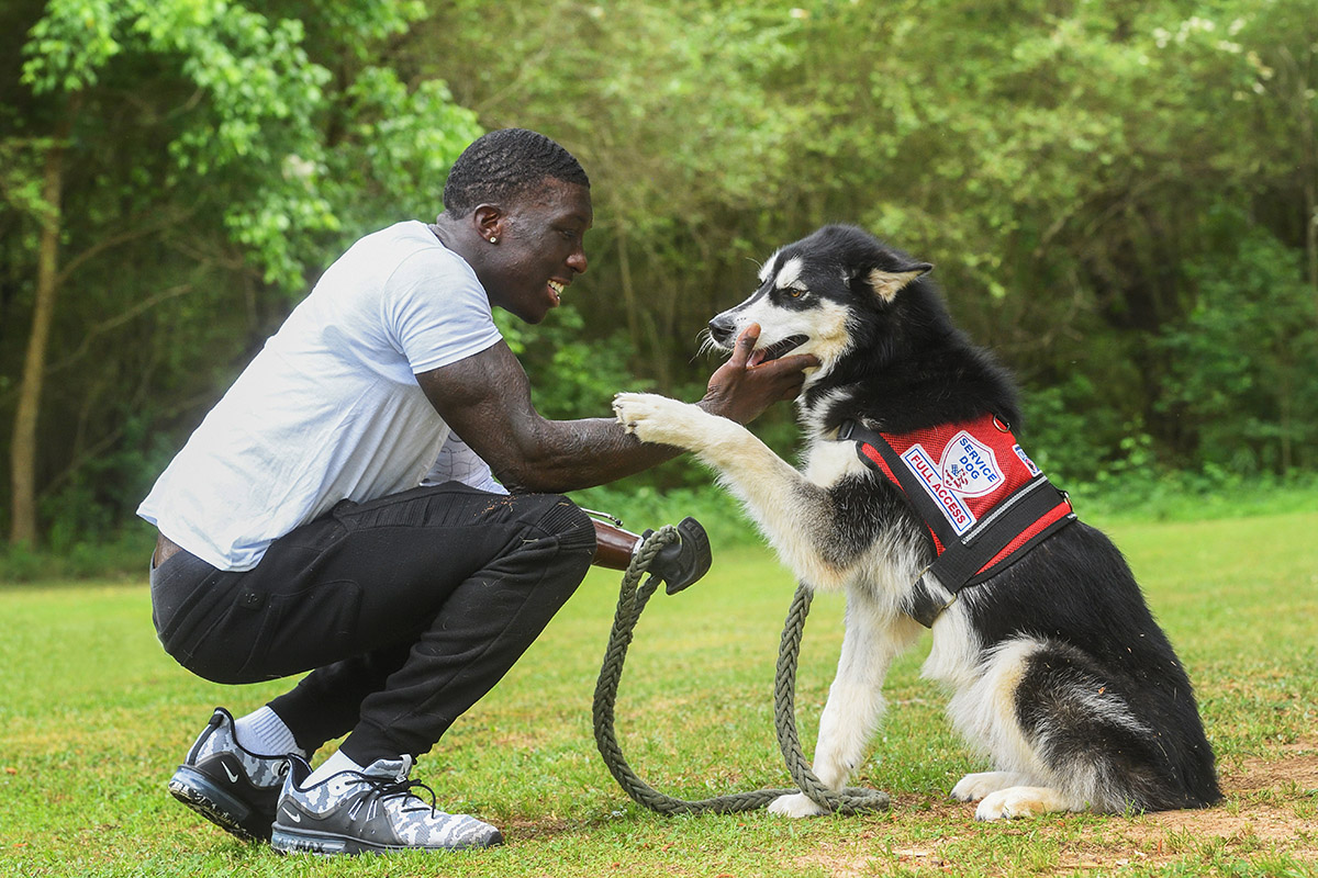 Jalen Richardson with his service dog Shadow