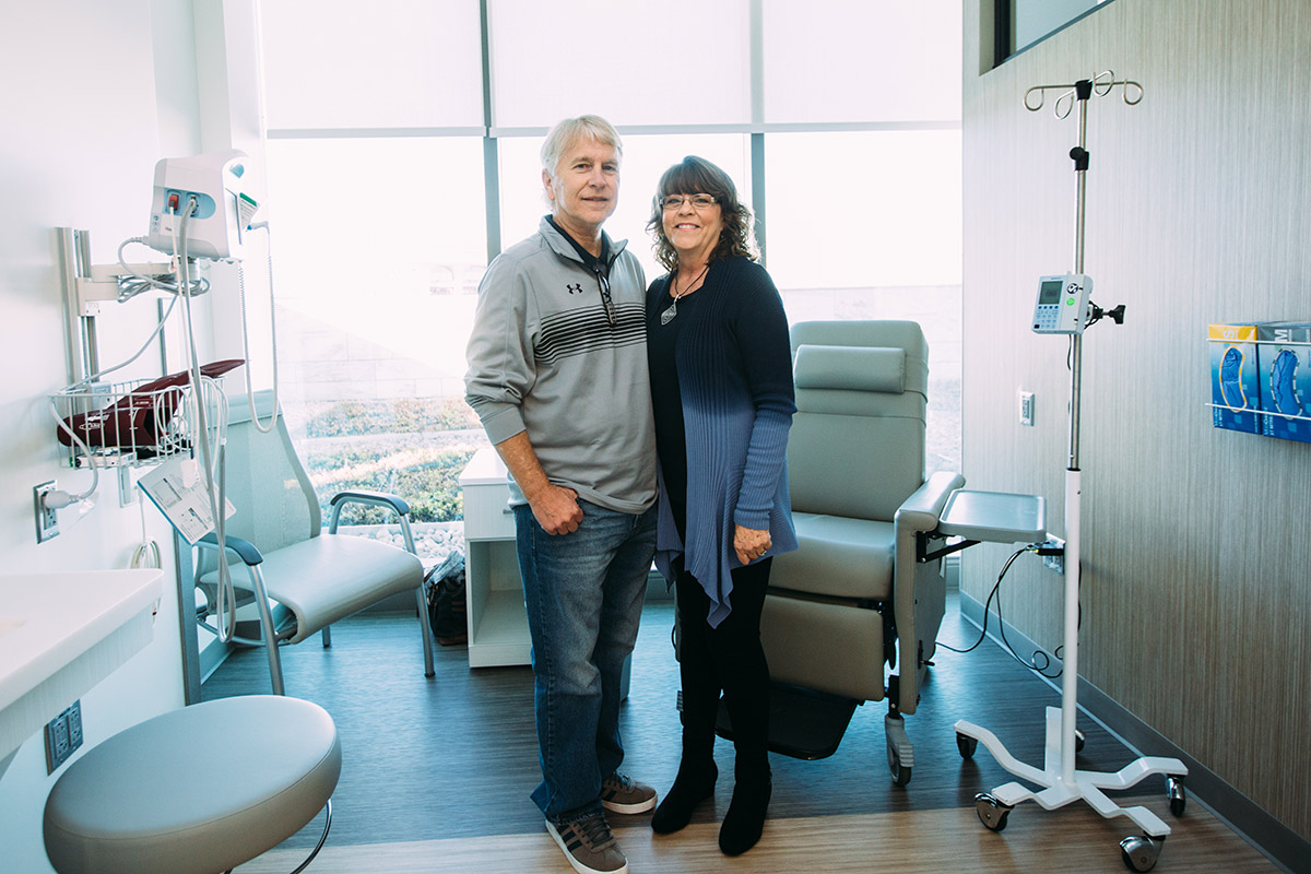 Couple standing in a cancer clinical trials center