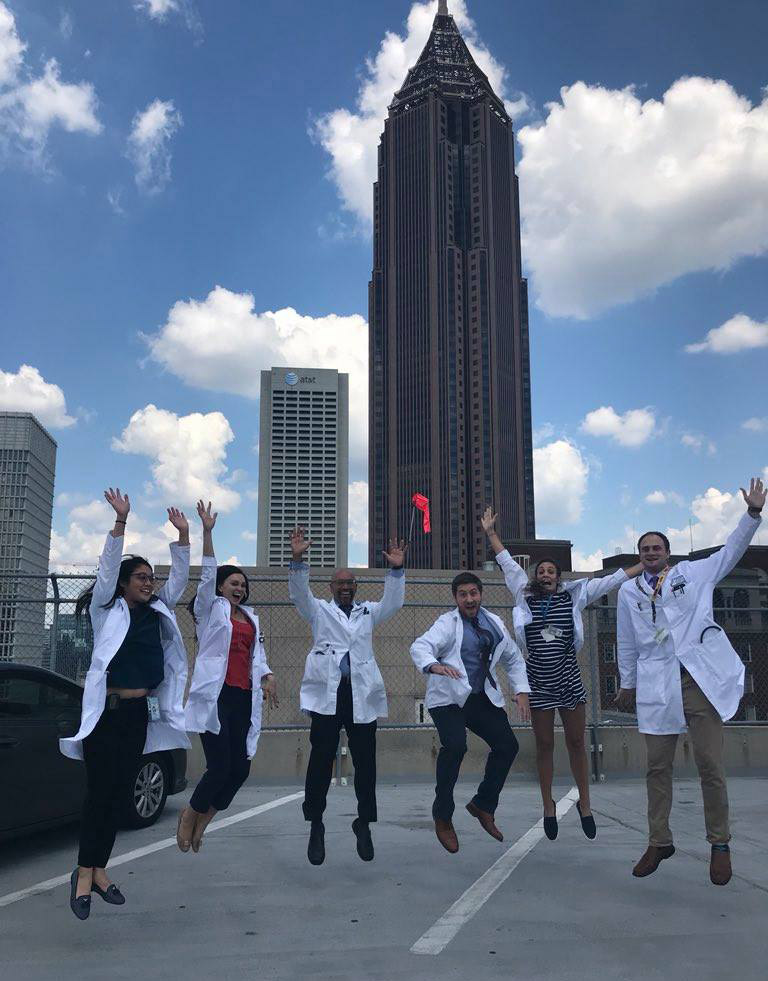 Doctors posing on top of a high hospital building