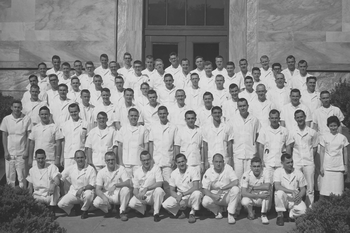 Group photo of the 1961 class of Emory Medical School students, all in white doctor coats.